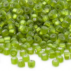 seed bead, dyna-mites™, glass, silver-lined translucent matte light green, #6 round with square hole. sold per 1/2 kilogram pkg.