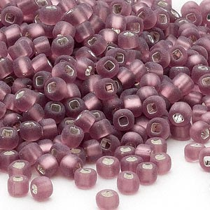seed bead, dyna-mites™, glass, silver-lined translucent matte lilac, #6 round with square hole. sold per 40-gram pkg.