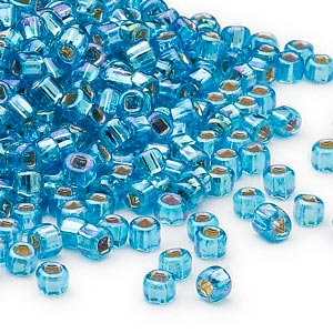seed bead, dyna-mites™, glass, silver-lined translucent rainbow aqua, #6 round with square hole. sold per 40-gram pkg.