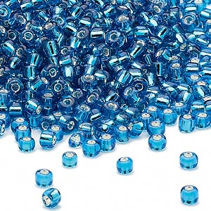 seed bead, dyna-mites™, glass, silver-lined translucent turquoise blue, #8 round. sold per 40-gram pkg.