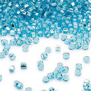 seed bead, dyna-mites™, glass, silver-lined transparent aqua, #11 round with square hole. sold per 1/2 kilogram pkg.