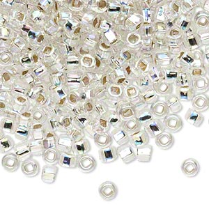 seed bead, dyna-mites™, glass, translucent silver-lined rainbow clear, #6 round with square hole. sold per 40-gram pkg.