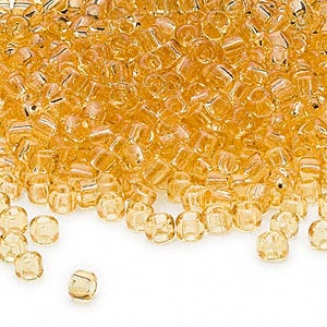 seed bead, dyna-mites™, glass, transparent light amber yellow, #6 round. sold per 40-gram pkg.