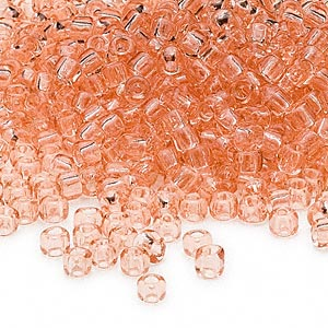 seed bead, dyna-mites™, glass, transparent light peach, #6 round. sold per 1/2 kilogram pkg.