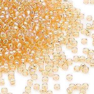 seed bead, dyna-mites™, glass, transparent rainbow amber yellow, #11 round. sold per 1/2 kilogram pkg.