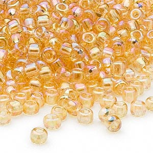 seed bead, dyna-mites™, glass, transparent rainbow amber yellow, #6 round. sold per 1/2 kilogram pkg.