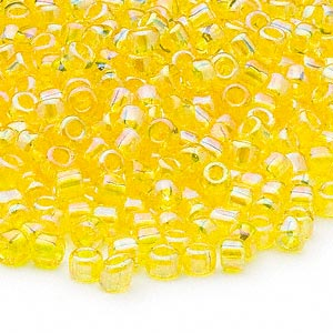 seed bead, dyna-mites™, glass, transparent rainbow yellow, #6 round. sold per 40-gram pkg.