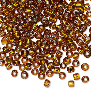 seed bead, glass, silver-lined translucent topaz brown, #6 round. sold per 20-gram vial.