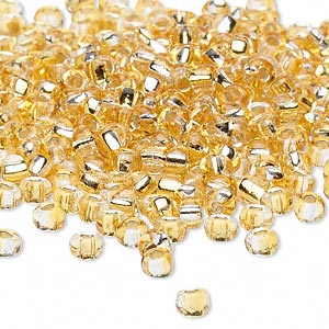 seed bead, glass, two-toned silver-lined light gold/silver, 3-4mm irregular round. sold per pkg of 25 grams, approximately 325 beads.