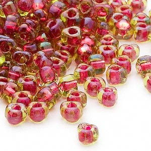 seed bead, miyuki, glass, transparent lime color-lined fuchsia, (tr1820), #5 triangle. sold per 250-gram pkg.