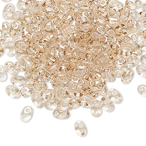seed bead, preciosa twin™, czech glass, transparent crystal honey, 5x2.5mm oval with 2 holes. sold per 10-gram pkg.