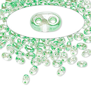 seed bead, preciosa twin™, czech glass, transparent light green-lined clear terra, 5x2.5mm oval with 2 holes. sold per 50-gram pkg.