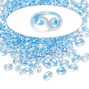 seed bead, preciosa twin™, czech glass, transparent sky blue-lined clear terra, 5x2.5mm oval with 2 holes. sold per 50-gram pkg.