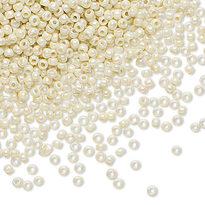seed bead, toho beads, glass, opaque rainbow light beige, (tr-11-409), #11 round. sold per 7.5-gram pkg.