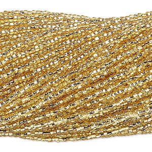 seed bead, vintage czech glass, silver-lined transparent gold, #9 round. sold per 1/2 kilogram pkg.